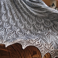 A silvery-grey lace shawl draped over an armchair