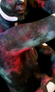 Close up of human torso painted with watercolour-like nebulae
