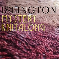 "Close up of a gold and red lace shawl, with overlaid text ""Islington Mystery Knitalong"""